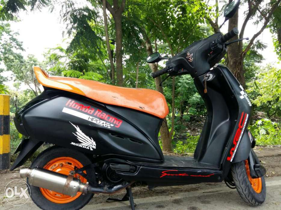 modified honda activa with Black & Orange Color