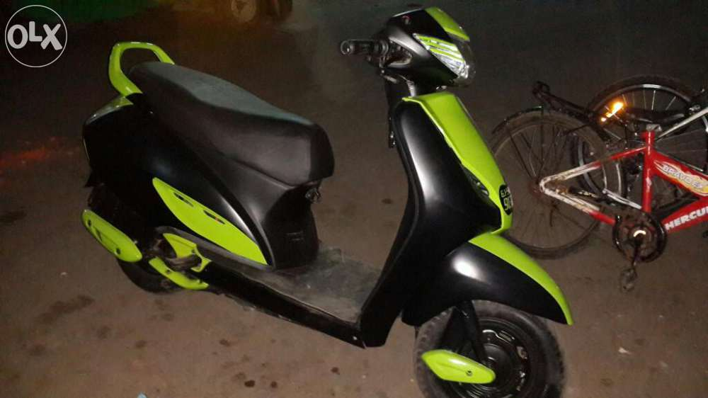 modified honda activa with Black and Green color
